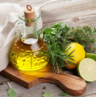 Olive oil, lemon, and fresh herbs for eating out on the AIP Diet at a Mediterranean Mezze Restaurant