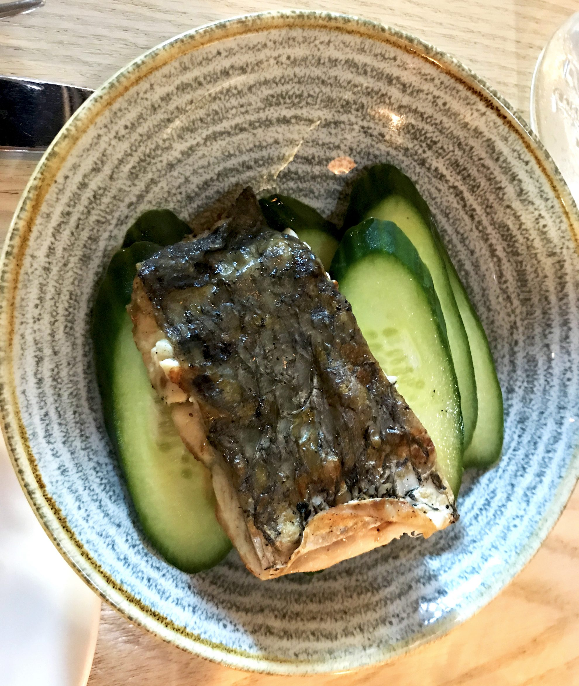 Delicious grilled seabass dish with cucumbers follows AIP dietary restrictions