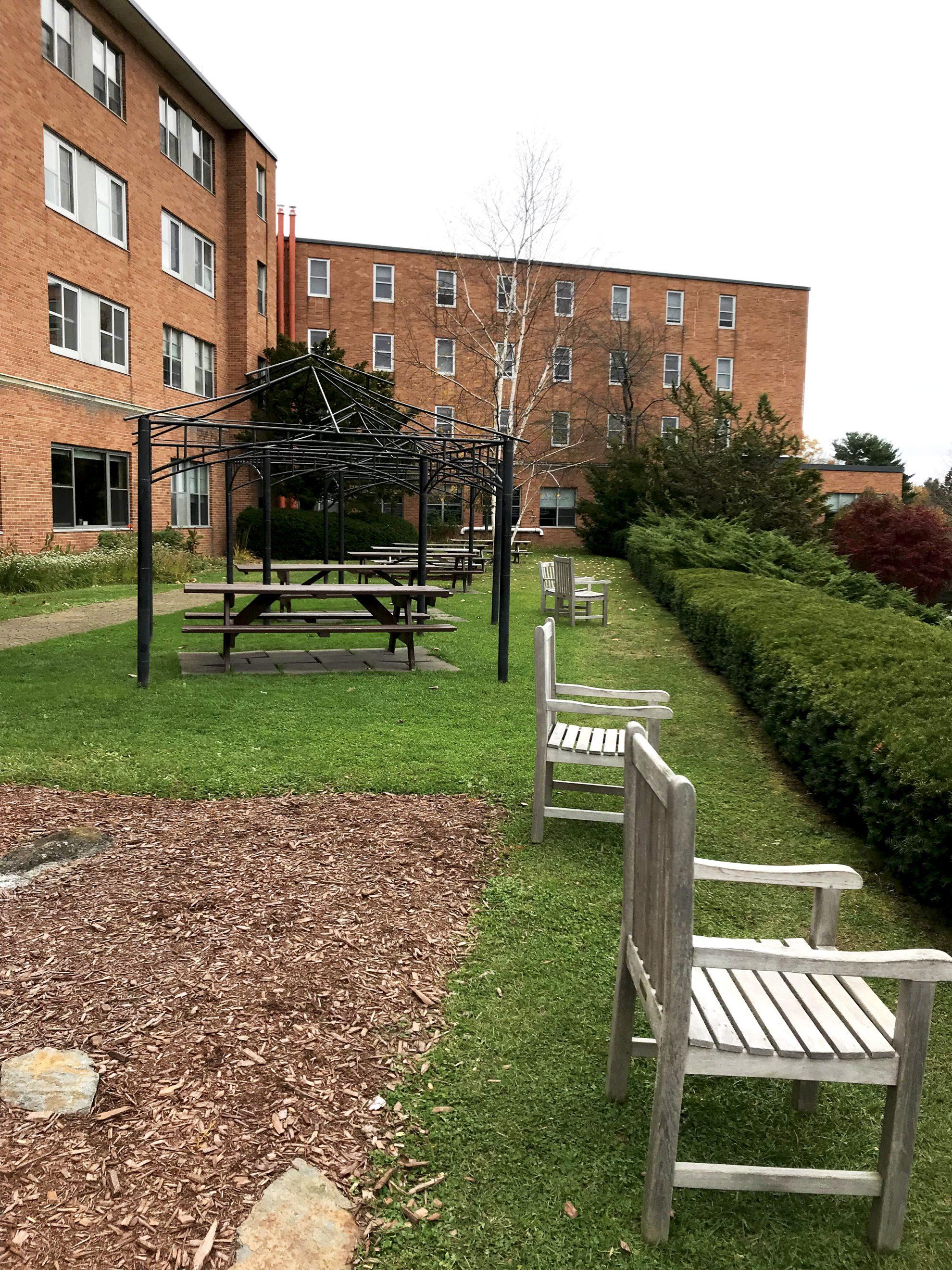 Brick building and benches at Kripalu Center Retreats