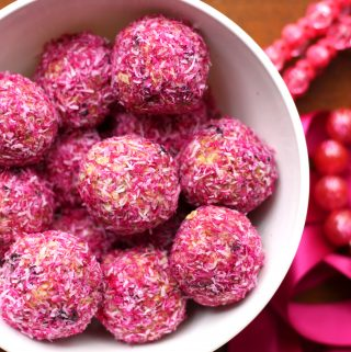 Naturally Pink Protein Snacks in a bowl. These naturally pink balls are a snack that keeps you full for hours!