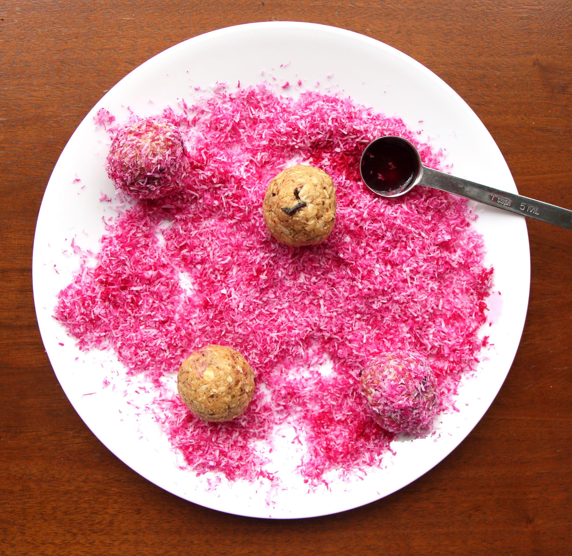 Plate with Naturally Pink Protein Snacks and naturally pink coconut flakes dyed with beet juice. Fun gluten-free snack for kids!