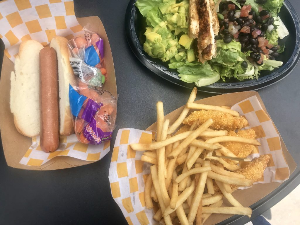 Enjoy gluten free hot dogs, salads, chicken tenders and french fries at Backlot Express in Hollywood Studios! An easy and delicious gluten free quick service meal in Disney World.