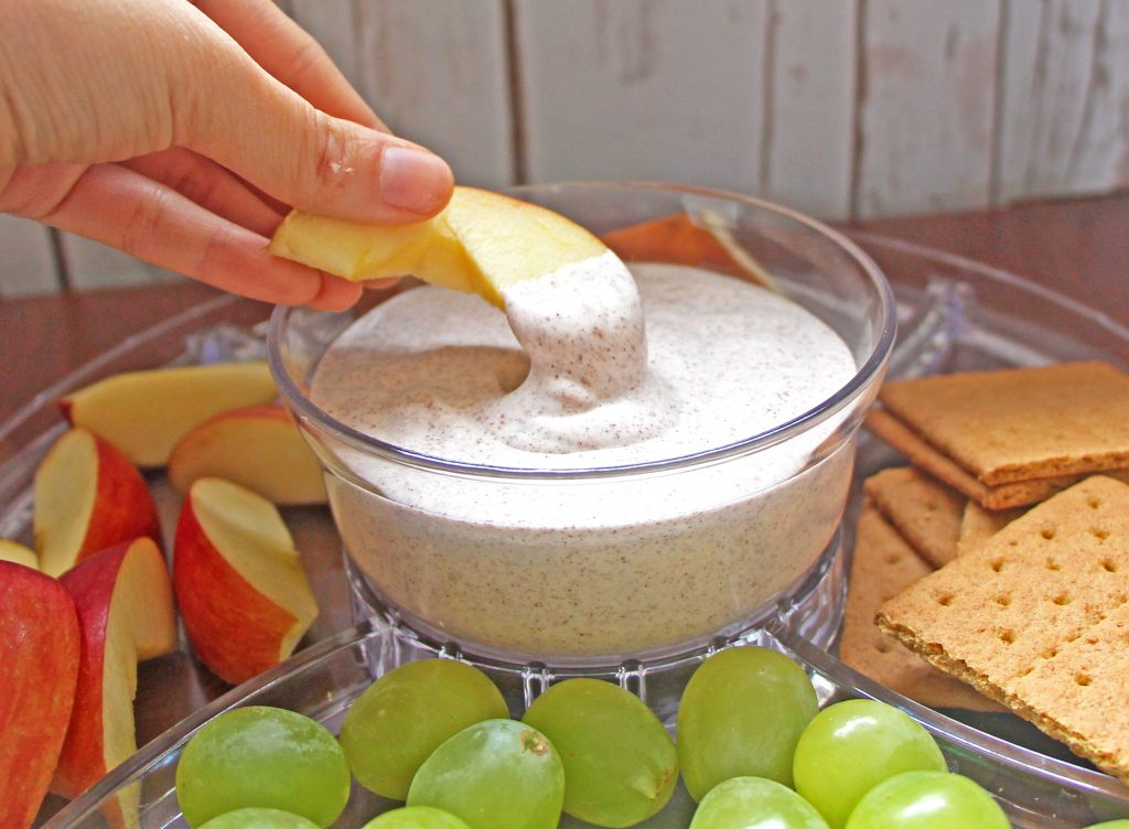 Easy and healthy vegan fruit dipping sauce with apples, grapes, and graham crackers