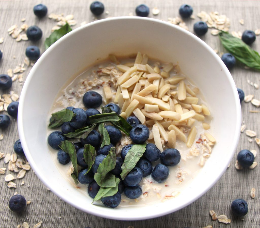 Tasty blueberry overnight oats are vegan and gluten free with healthy ingredients like chia seeds and maple syrup for sweetness.