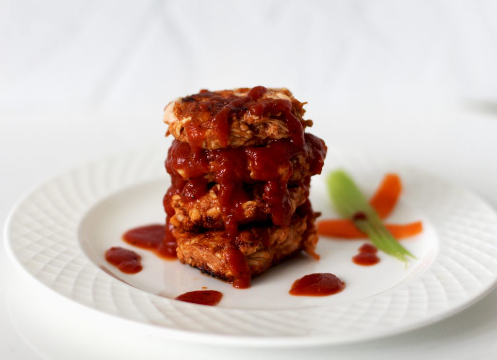 Stack of AIP BBQ Chicken Fritters with AIP BBQ sauce. An easy AIP chicken breast recipe the whole family will love!